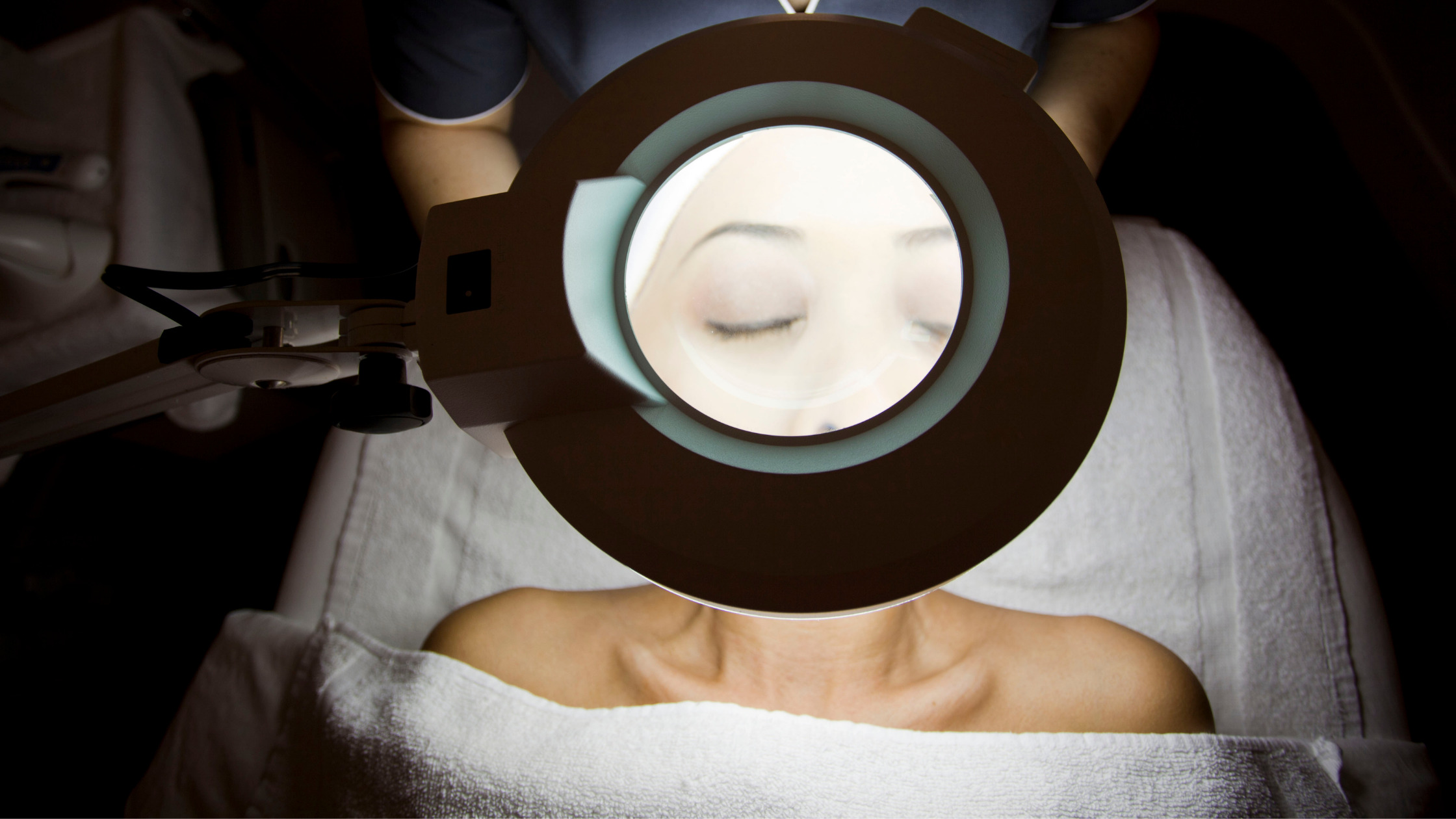 skin analysis under magnifying lamp